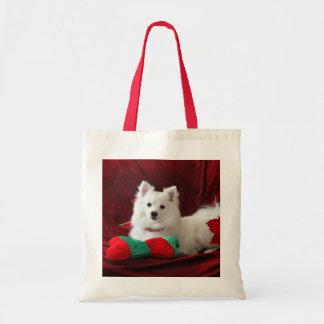Lucy American Eskimo on a bag