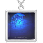 Luminescent illustration of a tsetse fly pendants