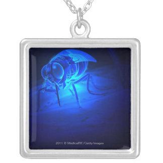 Luminescent illustration of a tsetse fly square pendant necklace