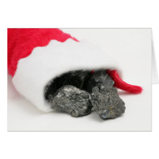 Lumps of coal spilling out of a Christmas Card