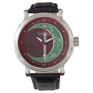 Luna céltica roja y verde relojes de pulsera