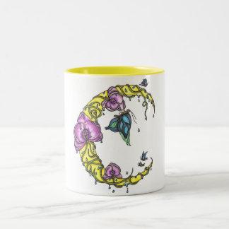 Luna con las orquídeas y la taza de las mariposas