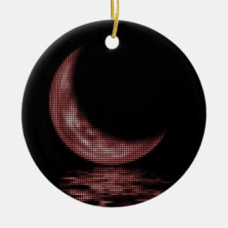 Luna creciente de la reflexión en rojo del lago adorno