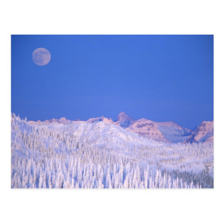 Luna Llena que sube sobre Parque Nacional Glacier Tarjetas Postales