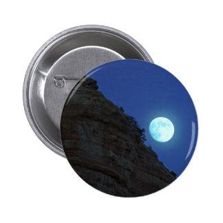 Luna Llena que sube sobre Sedona Pins