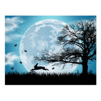 Luna mística con la silueta del conejo postales