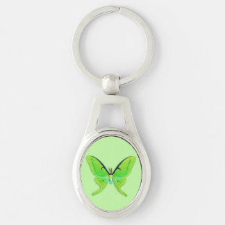 Luna moth on a pale green background Silver-Colored oval metal keychain