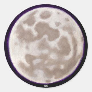 Luna pintada etiqueta redonda