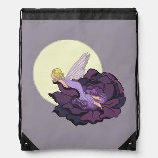 Luna que mira el cielo de hadas de la tarde de la mochilas