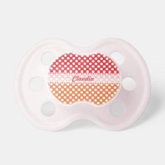 Lunar blanco, rojo y anaranjado chupete de bebe