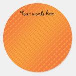 Lunares anaranjados en fondo anaranjado etiquetas redondas