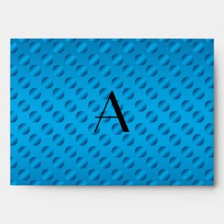 Lunares azules brillantes del monograma