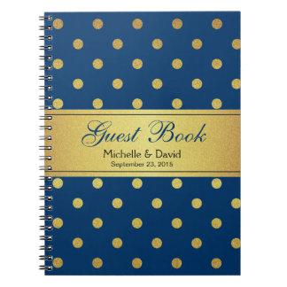 Lunares azules del brillo del oro del libro de libretas