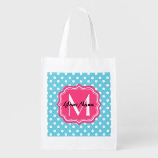 Lunares azules y blancos con el monograma rosado bolsa de la compra