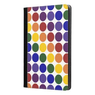 Lunares del arco iris en la caja en folio blanca