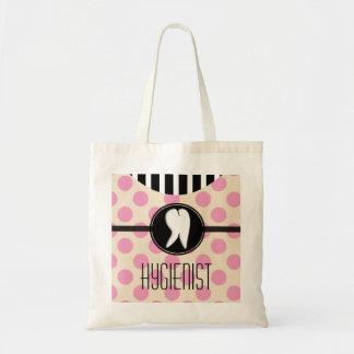 Lunares del rosa de la bolsa de asas del higienist