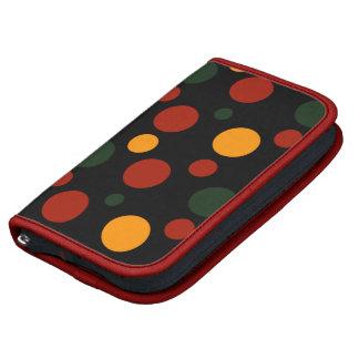 Lunares rojo, anaranjado y verde en negro planificador