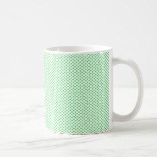 Lunares verdes en blanco taza de café
