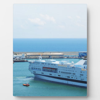 Luxurious cruise ship leaving Barcelona harbour Plaque