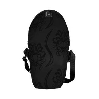 Luxury of ornamentation in black messenger bag