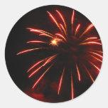 Luz tenue y explosión del rojo pegatina redonda