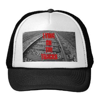 Lying on the tracks hat