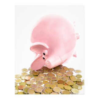Lying pink piggy bank with pile of euro coins letterhead