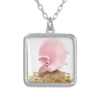 Lying pink piggy bank with pile of euro coins silver plated necklace