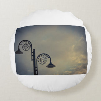 Lyme Regis ammonite lights Round Pillow