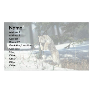 Lynx leaping, bounding on snow business card