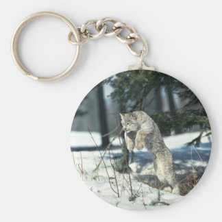 Lynx leaping, bounding on snow key chain