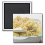 Macaroni cheese in baking dish with wooden 2 inch square magnet