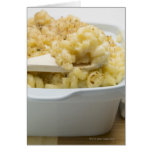 Macaroni cheese in baking dish with wooden card