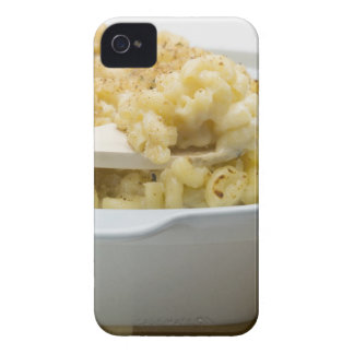 Macaroni cheese in baking dish with wooden iPhone 4 cover