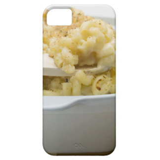 Macaroni cheese in baking dish with wooden iPhone 5 cover