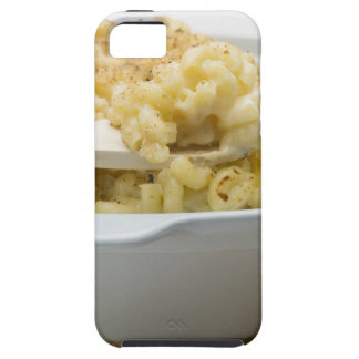 Macaroni cheese in baking dish with wooden iPhone 5 covers