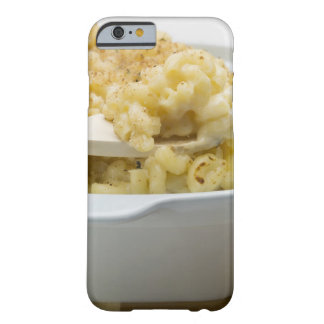 Macaroni cheese in baking dish with wooden iPhone 6 case