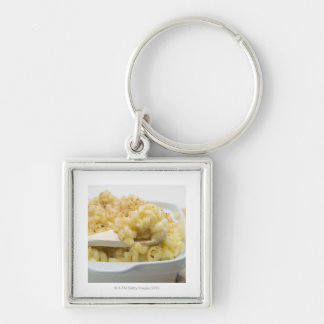 Macaroni cheese in baking dish with wooden keychain