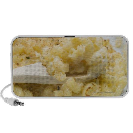 Macaroni cheese in baking dish with wooden mini speaker