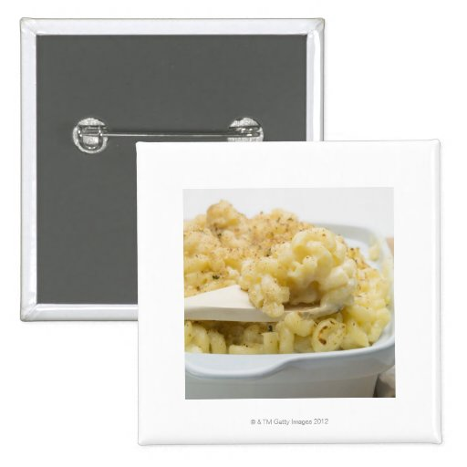 Macaroni cheese in baking dish with wooden pins