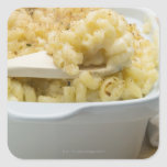 Macaroni cheese in baking dish with wooden square sticker