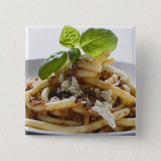 Macaroni with mince sauce and cheese button