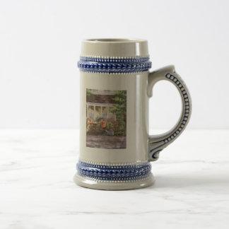 Macetas y un barril de la flor tazas de café