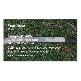 Machete on a grassy ground business card template