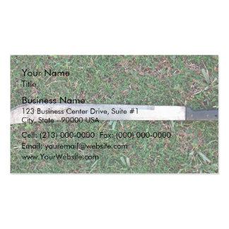 Machete on a grassy ground business cards