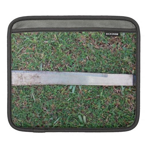 Machete on a grassy ground iPad sleeve