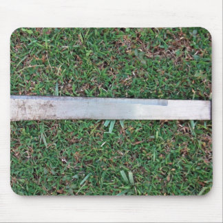 Machete on a grassy ground mouse pad