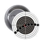 Machine gun bullet holes over shooting target buttons