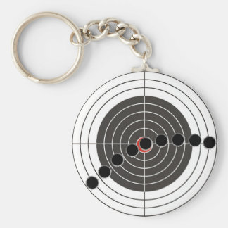 Machine gun bullet holes over shooting target keychain
