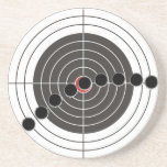 Machine gun bullet holes over shooting target sandstone coaster